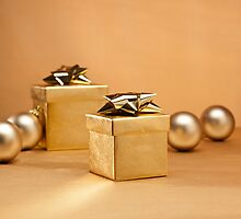 Gold bauble and present in Christmas setting by 3523studio
