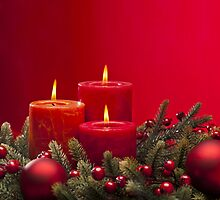 Red advent flower arangement with burning candles by 3523studio