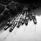 Canoes in Laos by possumhollow