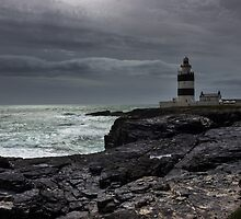 Hook Lighthouse Co. Wexford with steely grey clouds  by Leahburgess