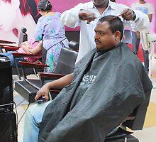Man Having Haircut by Andrew  Makowiecki