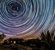 Amazing Galaxy Star Trails Spin Over Desert Cabin by Gavin Heffernan