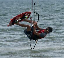 Close-up of male kite surfer upside down by Nick Dale