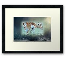 For now he waits, all alone, wild and free Framed Print