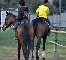 young boy riding horse by bayu harsa