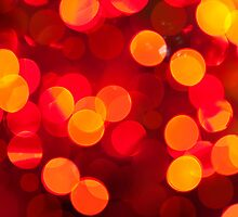 Red yellow sparkles and circles bokeh abstract  by Arletta Cwalina