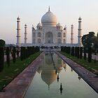 The Taj Mahal and reflective pool at dawn. by John Dalkin