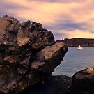 A Big Rugged Rock and a Little Yacht by myraj