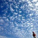 Le phare dans les nuages. by Jean-Luc Rollier