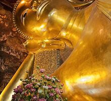 Face of Reclining Buddha gold statue, Bangkok, Thailand by Stanciuc