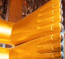 Feet detail of Reclining Buddha gold statue in Bangkok, Thailand by Stanciuc