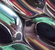 Reflections on spoons abstract by Caroline  Peacock