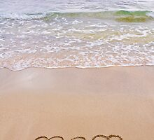 Two hearts drawn in the sand on a beautiful beach by Stanciuc