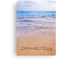 Connection word written on sand, with waves in background Canvas Print