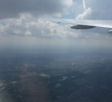 Airplane Window view  by JessicaCarr