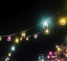 Colourful Swinging Lanterns by Silken Photography