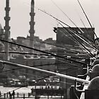 Fishing & thinking on Galata bridge by Hercules Milas