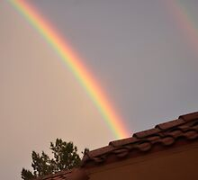 DOUBLE RAINBOW SITS ABOVE THIS HOME IN PALM DESERT by JAYMILO