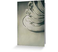 Four teacups and the small plate on the table Greeting Card