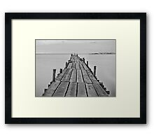Black and white photography of a beach wooden pier Framed Print