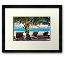 Sunbeds on exotic tropical palm beach Framed Print