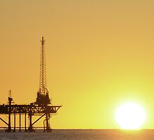 Offshore Oil Rig and Sun by Bradford Martin