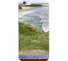 view of beach and cliffs in Ballybunion from bench iPhone Case/Skin