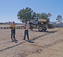 Fixing the sprayer, cotton farm, New south Wales by Margaret  Hyde