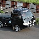 black colored suzuki carry by bayu harsa