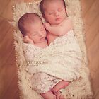 Twins in a Basket by ©Marcelle Raphael