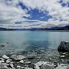 Into Lake Tekapo, New Zealand by Norman Repacholi