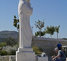 Statue and Mason, Croatia by Margaret  Hyde