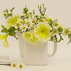 Teapot of Yellow Petunias And Daisies  by Sandra Foster