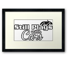 still plays with cars Framed Print