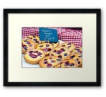 Delicious round raspberry tarts in British market Framed Print
