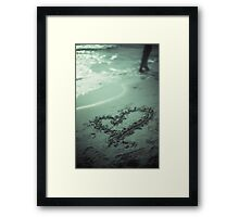 Love heart drawn on beach sand at low tide with ocean sea Framed Print