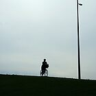 Lone cyclist by Maggie Hegarty