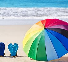 Summer background with rainbow umbrella and flip flops by ellensmile