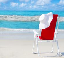 Beach chair with white hat by the ocean by ellensmile