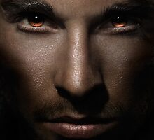 Closeup of man face with shining fierce eyes art photo print by ArtNudePhotos