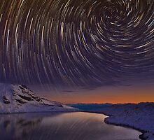 Star Trails over Frozen Lake by focuscreative
