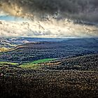 Storm Clouds along the Great River Road by Roger Passman