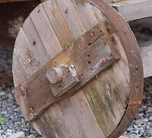 the old wooden wagon wheel by spetenfia