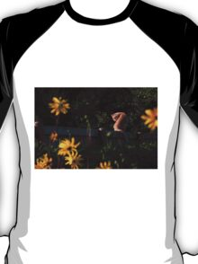 Ginger cat and yellow flowers T-Shirt