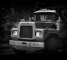 Big trucks drivin' through a small town by Clare Colins