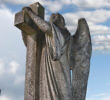 Angel statue embracing a cross  by morrbyte