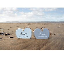 couple of inscribed wooden love hearts in the sand Photographic Print