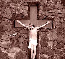 crusifix of jesus on wood cross by morrbyte
