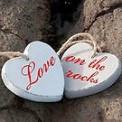 love on the rocks wooden hearts by morrbyte