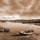 two beached fishing boats on Irish beach in sepia by morrbyte